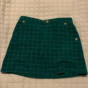 Green, corduroy skirt.